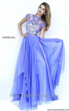Ravishing gown with cap sleeves by Sherri Hill.