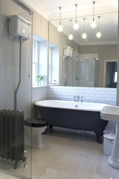 Nice bath, like metro tiles on wall, nice combination of retro bath and modern shower