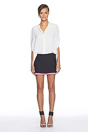 Closet staples like a black mini skirt and a loose blouse are great pieces to go from #CottonDaytoNight
