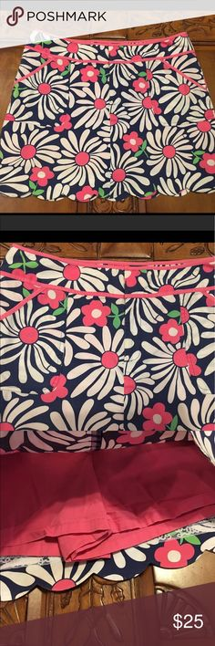 Lilly Pulitzer Scalloped Edge Skort Adorable skort with scalloped bottom. Side pockets. Fully lined. Very light small spot as pictured in last photo. It's incredibly hard to see I tried to capture it near the bottom large flower. Otherwise in excellent condition. Lilly Pulitzer Shorts Skorts
