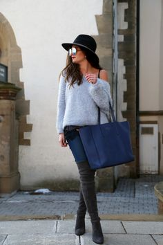 FashionHippieLoves. Black lace top+light blue off the shoulder sweater+skinny jeans+dark brown over the knee boots+blue tote bag+black hat+sunglasses. Winter Casual Outfit 2017