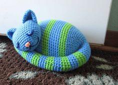 Ravelry: sleepy kitty doorstop pattern by Brenda K. B. Anderson in 'Crochet at Home'