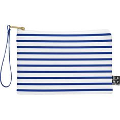 Nautical navy stripe wristlet. Keep your essentials handy when you're out on the town or strolling along the boardwalk featuring blue and white stripes.