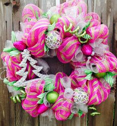 Stunning Pink & Green Christmas Wreath - we built a whole display including a white tree around these colours and that particular netting last year and it was stunning!