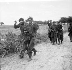 Waffen SS surrendering to British troops, unknown location, 1944 Normandy. These seem to be SS and they were not kind to allied POWs.