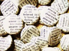 cute wedding favor idea, especially for those who like to read! buttons  made from pages of an old dictionary, all using words that have to do with love. how sweet!