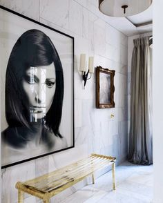 Decorating Ideas for Your Home's 5 Smallest Spaces// marble walls,gold bench, large photograph