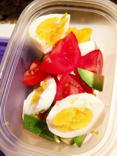 easy breakfast idea for on-the-go - This is a simple soft boiled egg a little avocado and a small tomato---all sliced mixed together and topped up with a little salt.- Whole30 Approved!