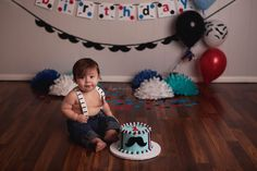 First birthday cake smash photo session with Alysia LeMaster Photography in Northeast Indiana. Baby boy mustache theme, red, blue, and black colors, one year photoshoot