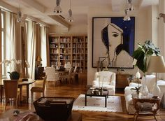 Love the book shelves, the artwork, the neutral color pallet, and floor to ceiling drapes. LOVE