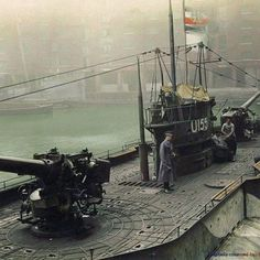 """The German submarine U-155 on display in St. Katherine docks, London, England, December 1918. The SM U-155 (formerly merchant submarine """"Deutschland"""") was a Type U-151 U-Kreuzer of the Kaiserliche Marine during World War I. Built at Flensburger Schiffbau, she was launched on 28 March 1916 as merchant submarine """"Deutschland"""" Deutschland was a blockade-breaking German merchant submarine used during World War I. It was developed with private funds and operated by the North German Lloyd Line."""