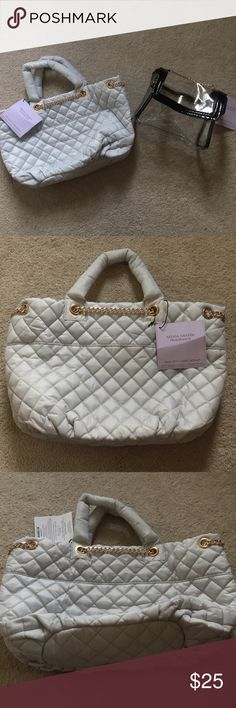 Ariana Grande Bag Bundle Ariana Grande quilted tote and cosmetic bag bundle! Brand new, no stains, scratches or tears. Best deal around! Both in perfect condition, can hold a whole lot and not to mention they are adorable! If you have any questions I'll gladly answer, and be sure to make an offer I'll accept anything reasonable! Ariana Grande Bags Totes