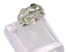 David Yurman 3 Row Confetti Ring with Peridot, Tourmaline and Diamonds. Get the lowest price on David Yurman 3 Row Confetti Ring with Peridot, Tourmaline and Diamonds and other fabulous designer clothing and accessories! Shop Tradesy now