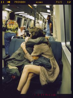 Public, transportation, couples, love, subway, transit, urban, city, hugging,