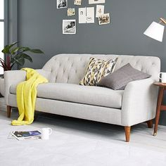 Ainslie Sofa. Classic tufting adds a timelessness to the mid-century lines of this sofa. Made in the USA. #westelm