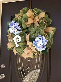 Deco mesh green wreath with burlap ribbon   https://www.facebook.com/pages/PJ-wreaths/502605376453015?ref_type=bookmark