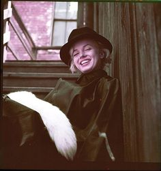 "Marilyn Monroe from ""Black Raincoat"" sitting by Milton Greene."