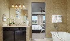 This beautiful master bath in Aurora, CO, boasts a relaxing soaking tub | Daley plan by Richmond American