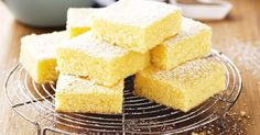 These moist Lemon Brownies use just a few ingredients and are ready in no time at all. Don't miss the Lemon Coconut Brownies, they're delicious! Lemon Desserts, Lemon Recipes, Sweet Recipes, Baking Recipes, Dessert Recipes, Tropical Desserts, Dessert Bars, Dessert Food, Lemony Lemon Brownies