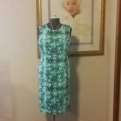 Liz Claiborne Sheath Dress Green pattern, sleeveless sheath dress. Has a lot of darts sewn throughout for a fitted look, zipper up the back, fully lined.  Mama's Closet item.  EUC 97% Cotton,  3% Spandex,  lining 100% Polyester  *Bundle 2 + items & save 10 % Liz Claiborne Dresses