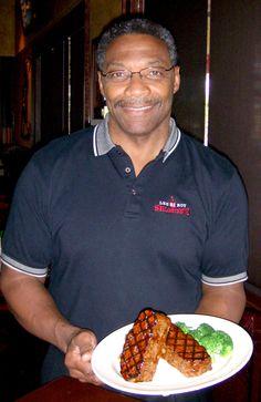 Lee Roy Selmon serving Mama's Meatloaf