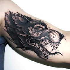 Best Sketch Style Wolf Tattoo on Bicep Tattoo Idea