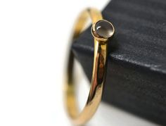 Tiny Moonstone Ring, Natural Grey Gemstone, 14K Gold Filled Band, Simple Stacking Jewelry by fifthheaven on Etsy https://www.etsy.com/listing/183084575/tiny-moonstone-ring-natural-grey