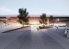 A football pitch hovers above basketball courts in this winning campus design.