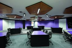 This is one of the hundreds of RMIT Classrooms, each one a little different to the last. The purple and white match well together.  The room itself is designed to be very spacious, and give each student an equal amount of room. The design which sets this room apart from a normal room is the design of where the lights are placed on the roof, and the shape they hold.