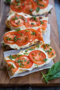 Everyone always LOVES these delicious and simple toasts. A crusty baguette toasted with fresh mozzarella and tomato and garnished with basil.