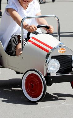 Shop Kids Classic Pedal Ride-On Car Toy. Baghera's 'Classic' pedal car toy is rendered in smooth metal that's accented with bold racing stripes. Racing Stripes, Pedal Cars, Vintage Inspired, Baby Strollers, Baby Kids, Kids Shop, Toys, Children, Classic