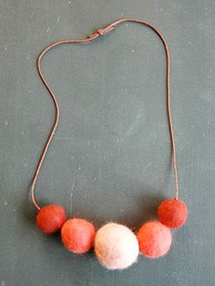 felted ball necklace. says it's a good kid craft idea...but i think it will also be good for me.