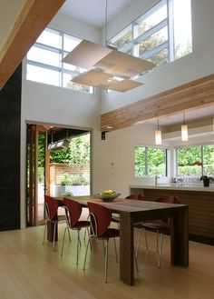 Lighting idea: hang lights over island and use recessed lights in dining room