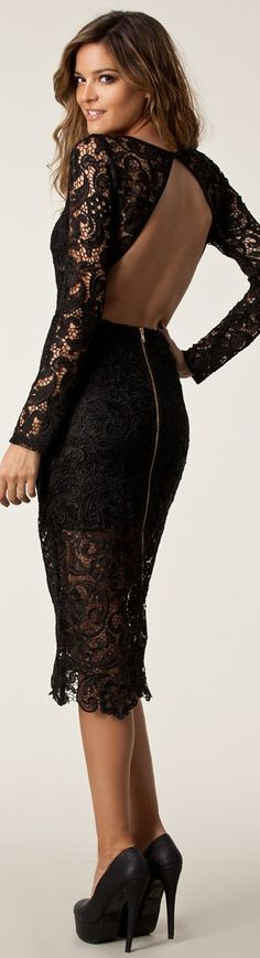 Black lace open back dress and towering high heels