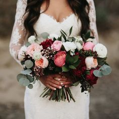 wedding bouquet in pink and reds
