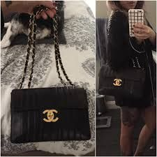 39f66670d39d The Chanel Classic Mademoiselle Vintage Jumbo Vertical Quilted Maxi Xl Flap  Ghw Black Lambskin Leather Shoulder Bag is a top 10 member favorite on  Tradesy.