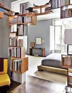 15 Lovely Libraries in Unexpected Places // gray bedroom, archway bookcase