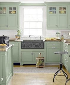 What a pleasing country kitchen design. The sage green kitchen cabinets are a beautiful color. And don't miss the custom-carved apron-front sink made of slate. Green Kitchen Cabinets, Kitchen Redo, New Kitchen, Kitchen Dining, Kitchen Ideas, Upper Cabinets, Kitchen Country, Colored Cabinets, Mint Kitchen