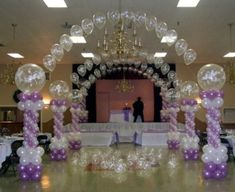 Love this idea but would use my wedding colors so the clear balloons would be white or blue, and the purple would be a little darker Wedding Balloon Decorations, Quinceanera Decorations, Wedding Balloons, Parties Decorations, Wedding Centrepieces, Balloon Dance, Cheap Wedding Reception, Wedding Receptions, Reception Entrance