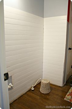DIY Wood Planked Wall Thrifty Decor Chick: Planking in her bathroom. March Purchase planking at Home Depot or Lowe's – they are similar to the beadboard planks (like on her kitchen) but without the bead. for six 8 foot bo Wood Plank Walls, Wood Planks, Planked Walls, Wall Wood, Plank Wall Bathroom, Shiplap Bathroom, Family Bathroom, Bathroom Faucets, Small Bathroom