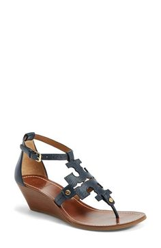 Free shipping and returns on Tory Burch 'Chandler' Wedge Leather Sandal (Women) at Nordstrom.com. The instantly recognizable double-T logo dominates on a minimalist thong sandal that proudly displays your pedicure—and love for all things Tory. A stacked, wooden wedge lends just-enough height and easy sophistication, allowing you to wear the style with both casual and dressier ensembles.