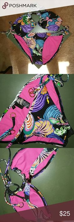 Ted Baker 2 piece swimwear. NWOT 2 piece tropical print bikini . Halter top with padded insert. Tie string bikini the hygiene tag removed. New never worn . Black marking on the tags to prevent returning  back to the store. Small black dot marking underneath the bikini tags. Pink lining. Ted Baker Swim Bikinis