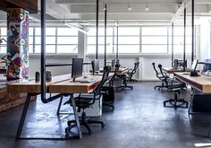 Dynamic Urban Office by Studio Roy David industrial pipes supporting top