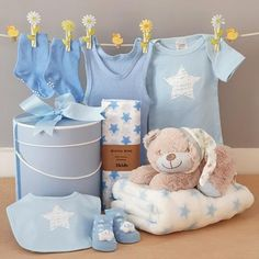 what a fabulous baby boy gift hamper, with a cute little sleepy teddy bear as well as a soft baby blanket and all the essentials a new baby boy will need all presented in a hat box tied with matching ribbons. Baby Boy Gifts, Gifts For Boys, Baby Shower Gifts, Teddy Toys, Teddy Bear, Sleepy Bear, Soft Baby Blankets, Baby Clothes Patterns, Cute Stars