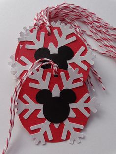 Items similar to 10 Mickey Mouse Christmas Gift Tags - Holiday Tags - Red Bakers Twine - White Snowflakes - Gift Wrapping Packaging - Party Favor Tags on Etsy Disney Christmas Crafts, Mickey Mouse Christmas Tree, Mickey Mouse Ornaments, Disney Crafts, Kids Christmas, Christmas Tree Ornaments, Disney Diy, Grinch Christmas, Bricolage Noel