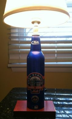 DIY beer bottle lamp. Iffy, but with the German beer bottle it might look neat.