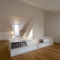 Staircase cum bookshelves inside the House at Janelas Verdes by Portugese architect Pedro Domingos Arquitectos.