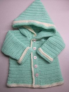 cute little cardigan, i think it would be a great gift for our niece done in a bright varegated plus black trim