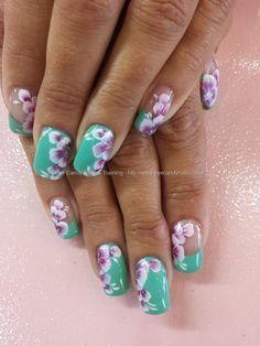 Mint green gel polish with one stroke flower nail art
