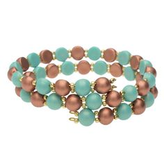 Get ready for a tropical getaway with this turquoise and bronze memory wire wrap bracelet featuring Czech Glass 2-Hole Cabochon beads surrounded by Toho seed beads.